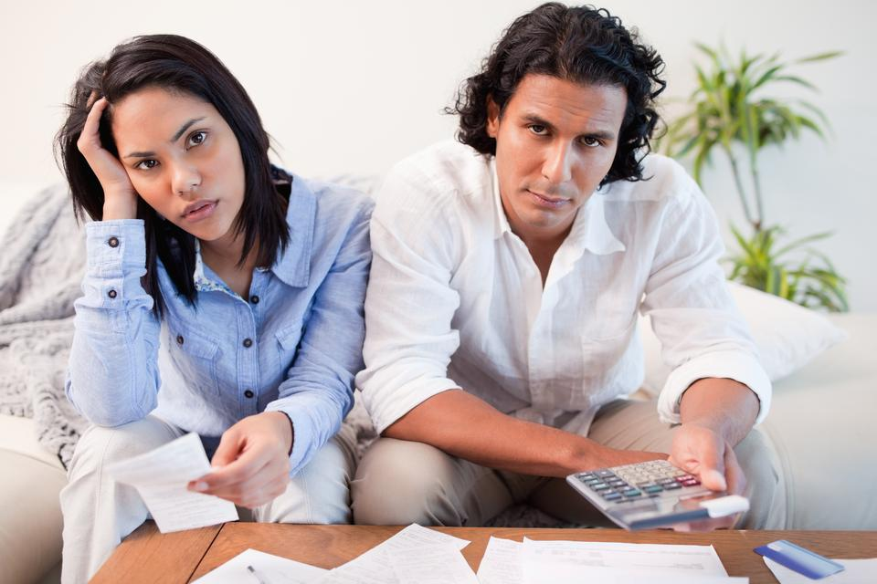 """""""Couple calculating their costs"""" stock image"""
