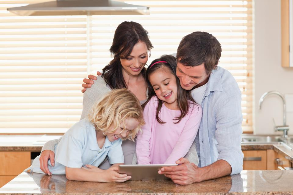 """""""Family using a tablet computer together"""" stock image"""