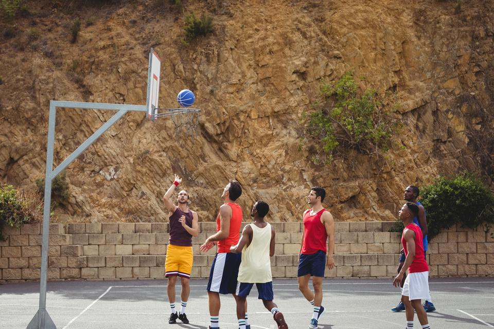 """Basketball players playing basketball in the court"" stock image"