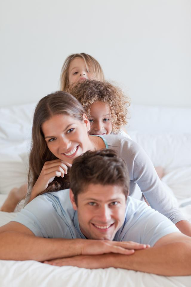 """""""Portrait of a family lying on each other"""" stock image"""