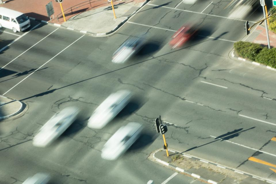 """""""High angle view of blurred cars on road intersection"""" stock image"""