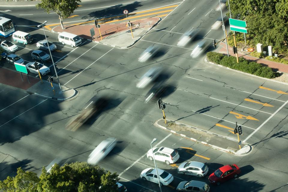 """""""Blurred motion of cars on road intersection"""" stock image"""