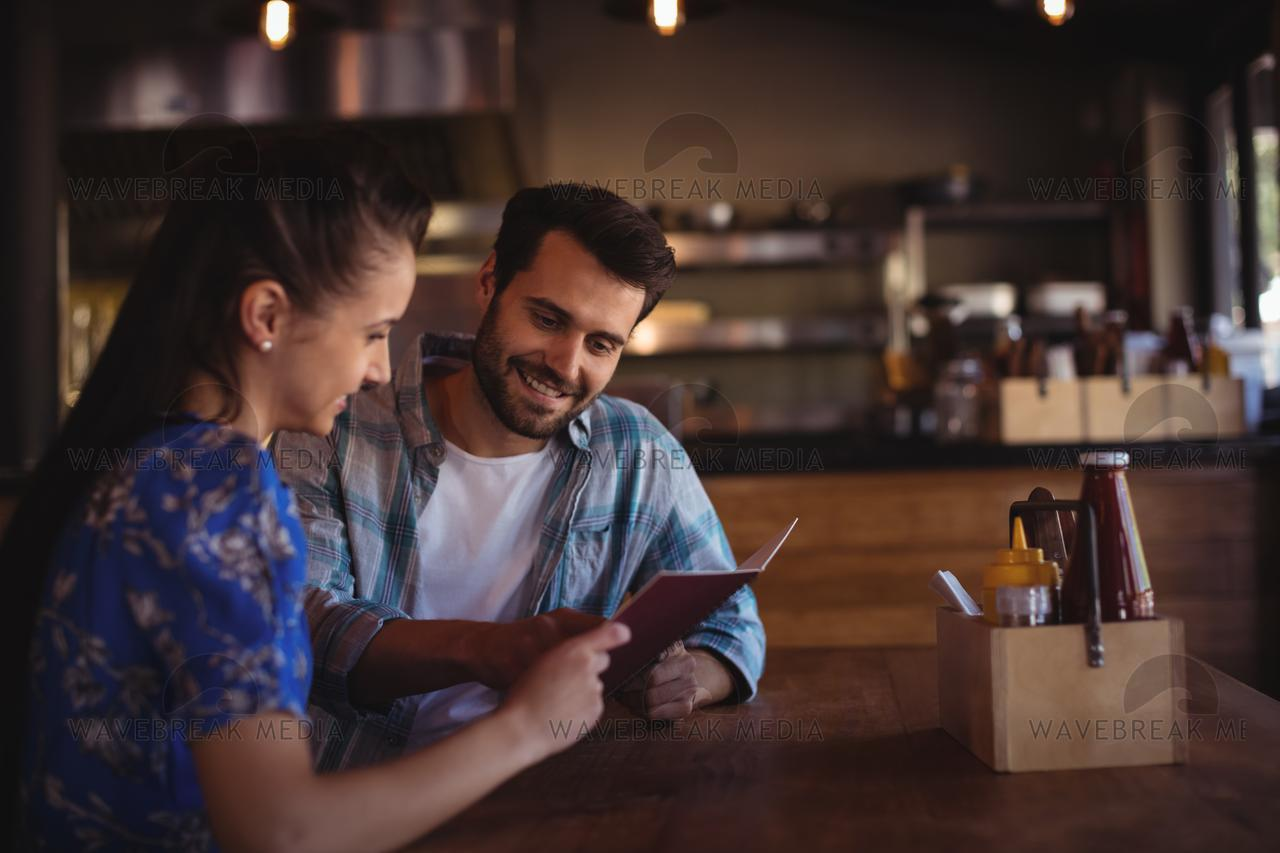"""Couple looking at menu"" stock image"