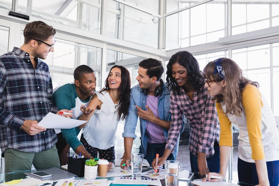 """""""Young business team discussing at creative office"""" stock image"""