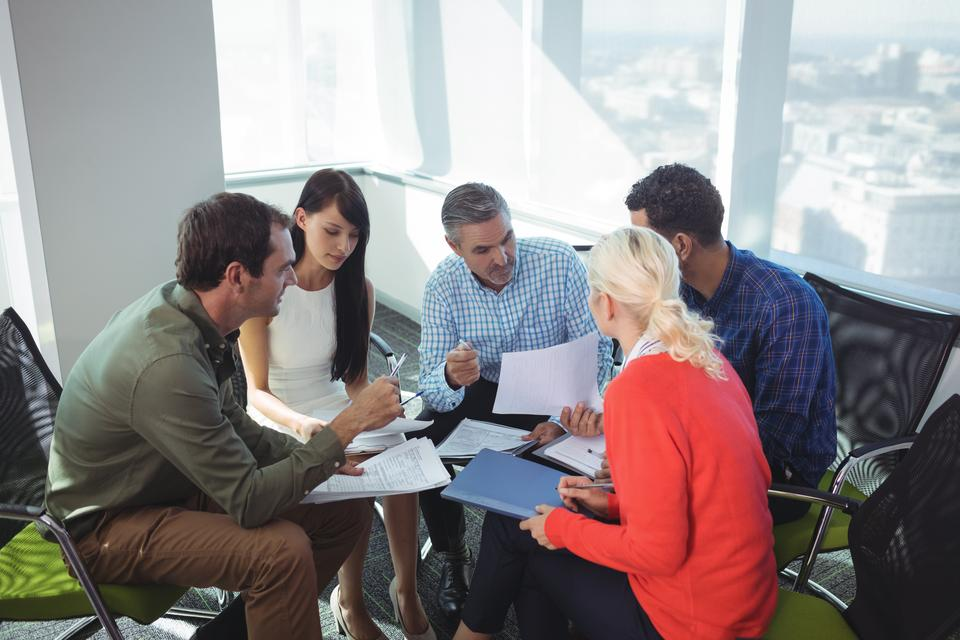 """""""Business people discussing together at office"""" stock image"""