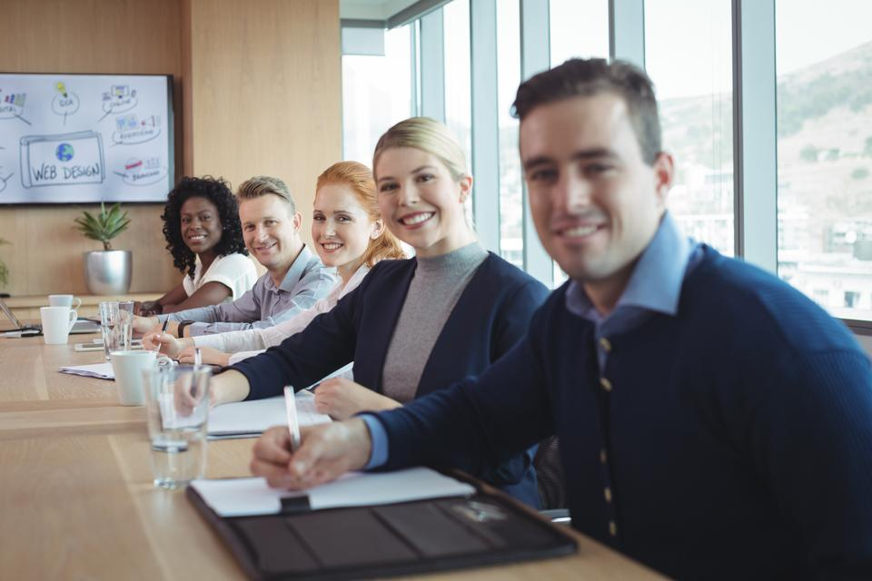 """""""Portrait of smiling business people sitting at office"""" stock image"""
