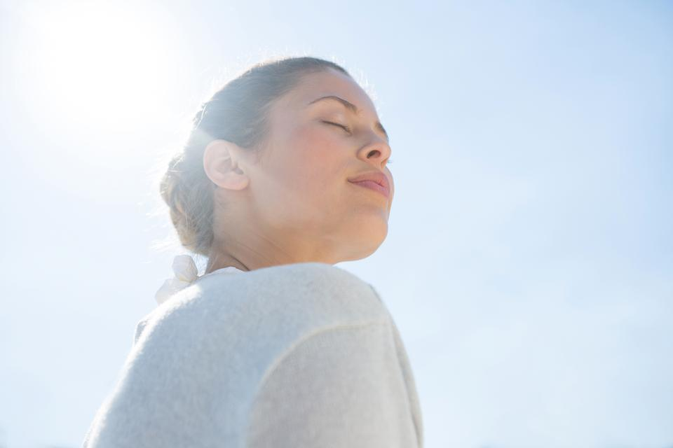 """""""Low angle view of woman with eyes closed"""" stock image"""