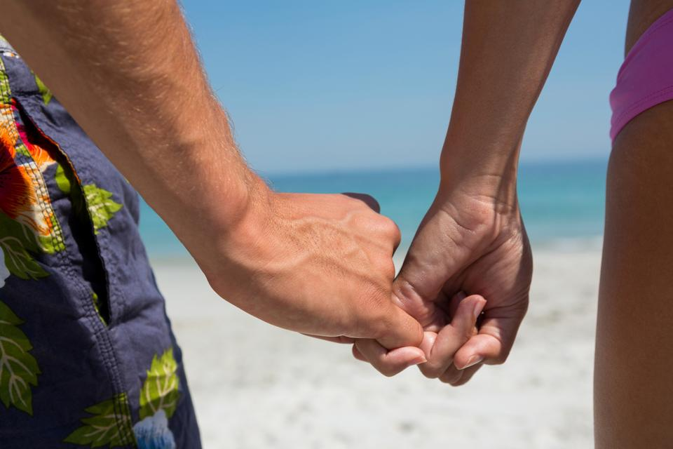"""""""Cropped image of couple holding little fingers"""" stock image"""