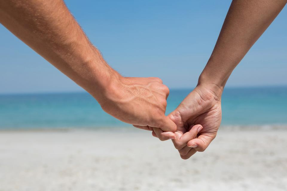 """""""Cropped hands of couple holding little fingers"""" stock image"""