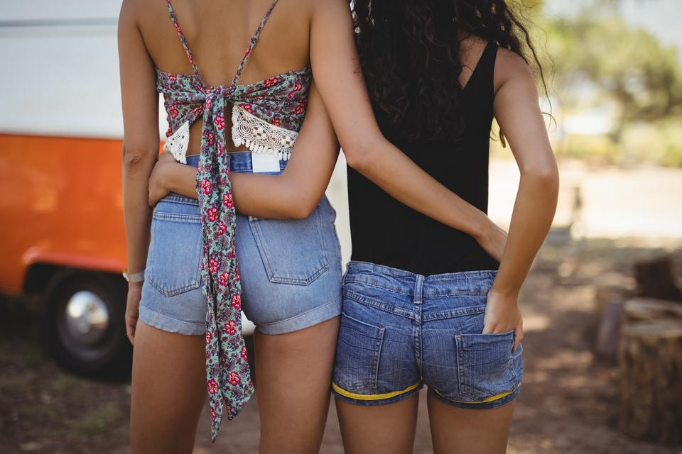 """Rear view of female friends on field"" stock image"