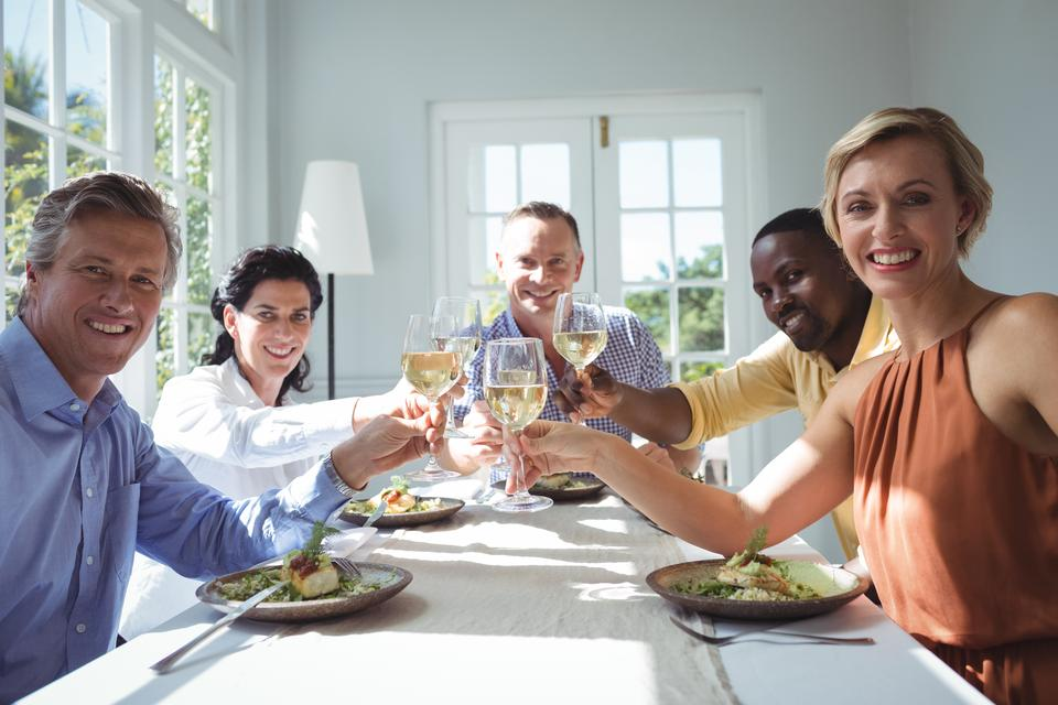 """""""Group of happy friends toasting glasses of wine"""" stock image"""