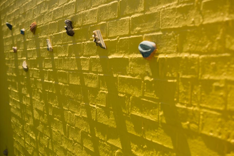 """Full frame shot of yellow climbing wall"" stock image"