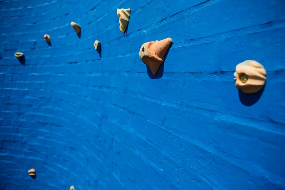"""Full frame shot of blue climbing wall"" stock image"