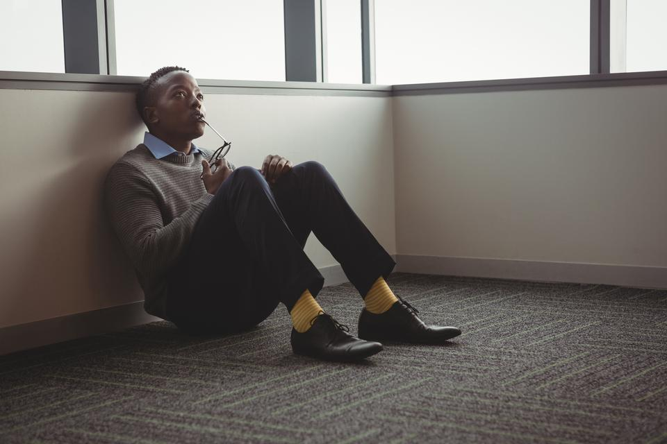 """""""Thoughful executive sittng on floor"""" stock image"""