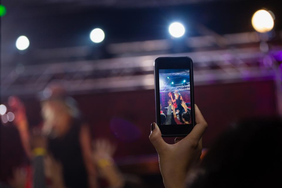"""""""Audience recording video of band on mobile phone"""" stock image"""