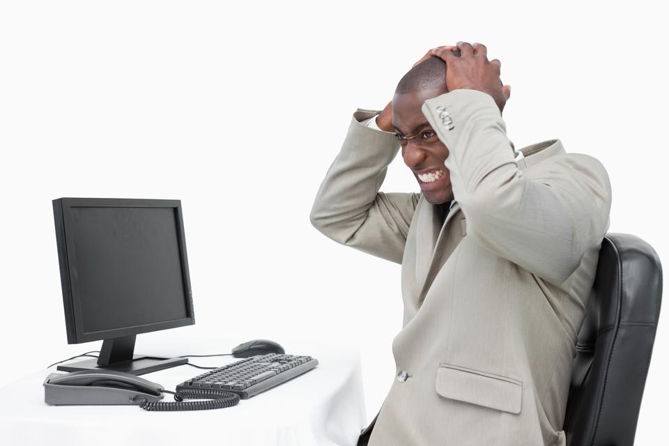 """""""Furious businessman using a monitor"""" stock image"""