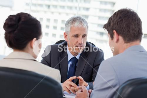 Entrepreneurs having a serious meeting with their banker
