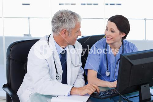Medical team working with a computer