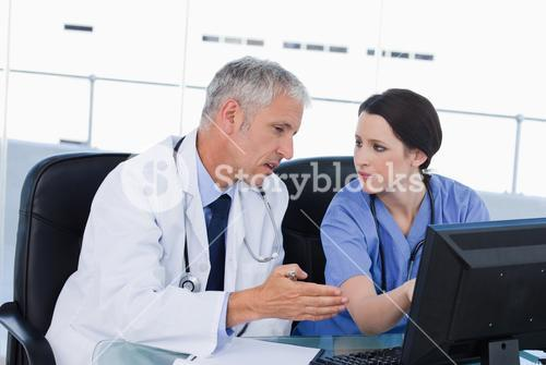 Serious medical team working with a computer
