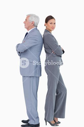 Mature businessman back-to-back with colleague