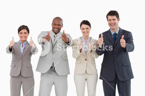 Smiling sales team giving thumbs up