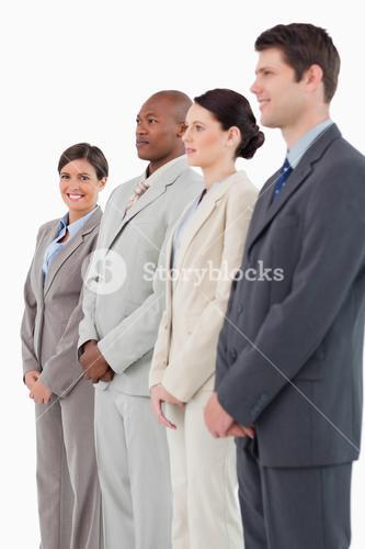 Smiling saleswoman standing next to her colleagues