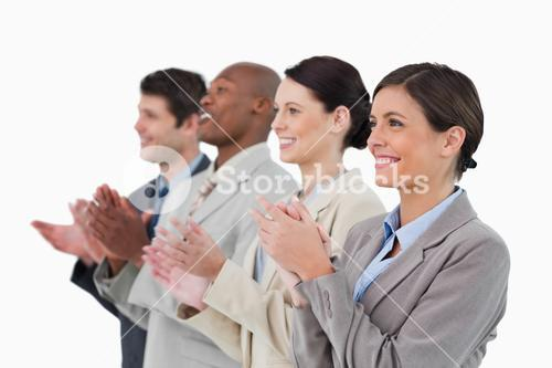 Side view of applauding sales team