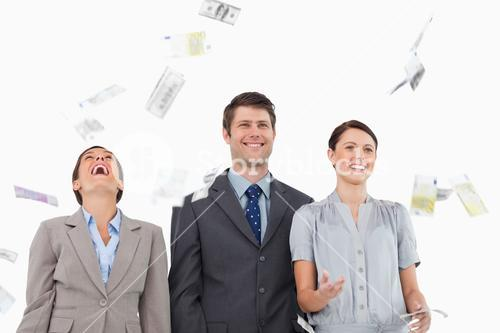 Money falling down on smiling salesteam