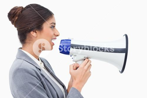 Side view of saleswoman using megaphone