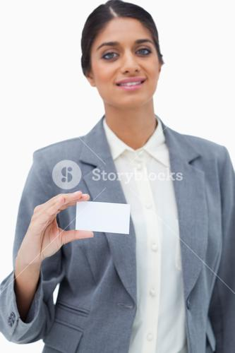 Tradeswoman showing blank business card
