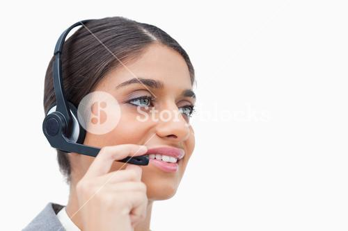 Side view of female call centre agent with headset