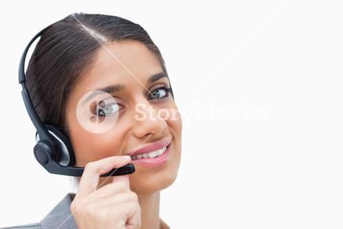 Smiling call centre agent with her headset
