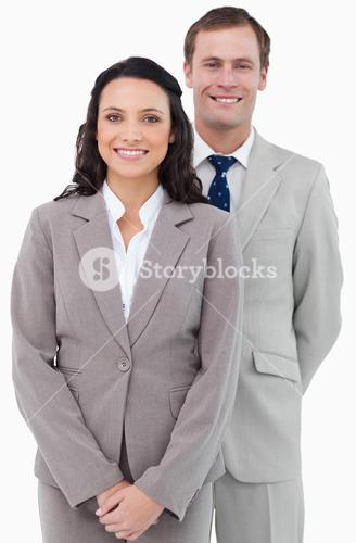 Smiling office staff standing together