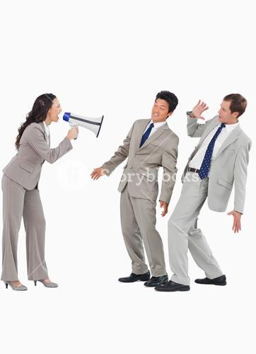 Saleswoman with megaphone yelling at colleagues