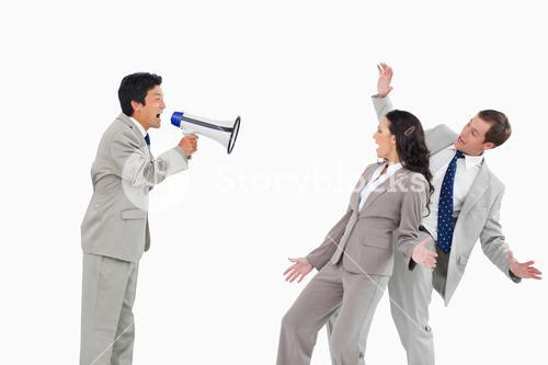 Salesman with megaphone yelling at colleagues