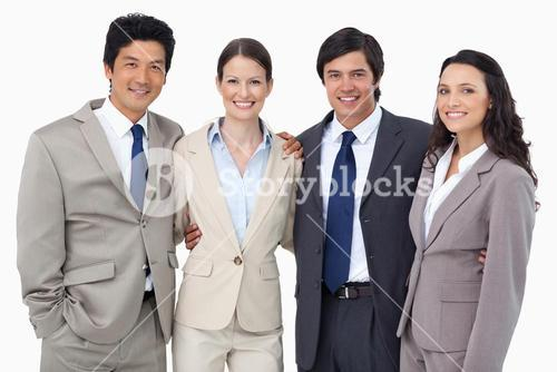 Smiling salespeople standing together