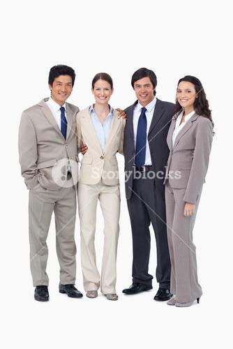 Smiling young salespeople standing together