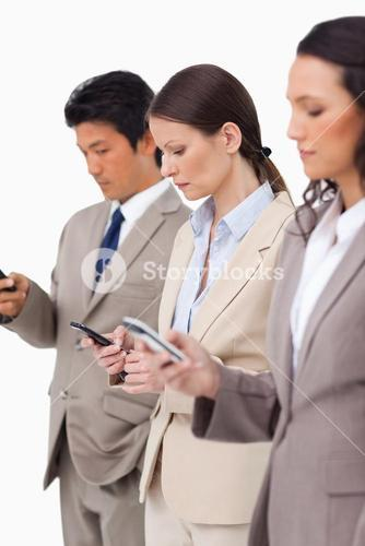 Group of business people with their cellphones