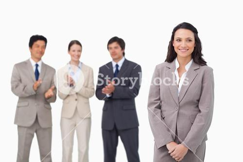 Businesswoman getting applause by colleagues