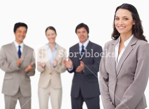 Saleswoman getting applause from her colleagues