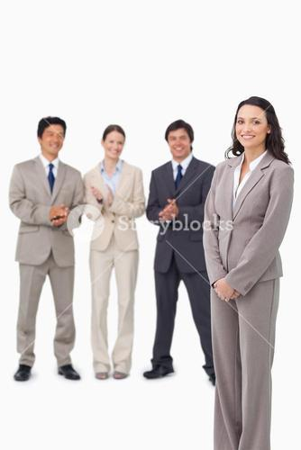Businesswoman getting applause by her colleagues