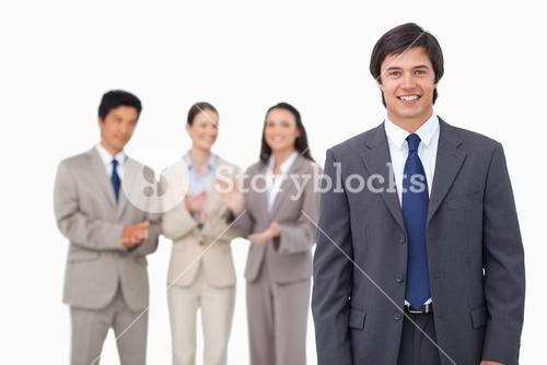 Businessman getting applause from colleagues