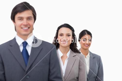 Smiling businesspeople standing in line