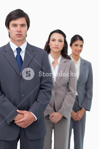 Young businesspeople standing in line