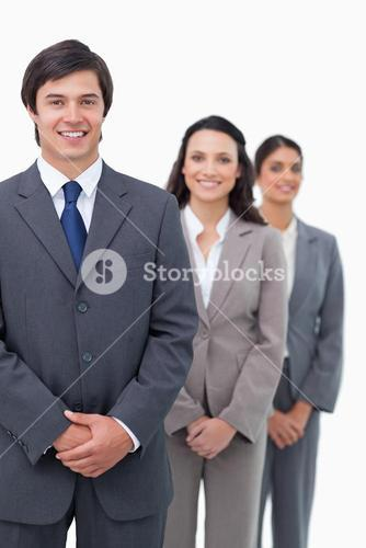 Smiling young businesspeople standing in line