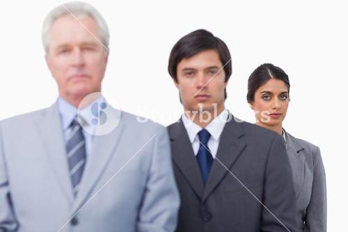 Mature businessman with his employees