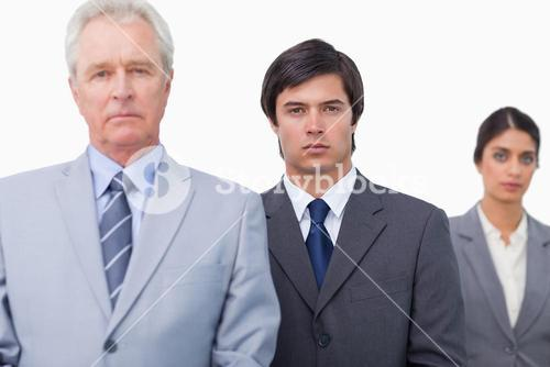 Mature salesman with his employees