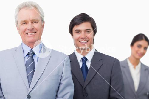 Smiling mature salesman with his employees