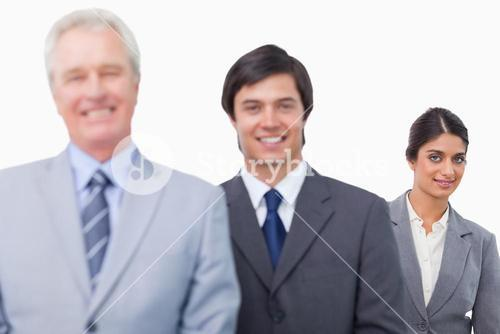 Smiling mature businessman with his employees
