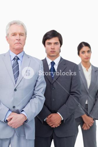 Mature tradesman standing with his employees
